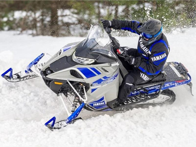 Rider cornering in the snow on a 2018 Yamaha Sidewinder S-TX DX 137  Snowmobile