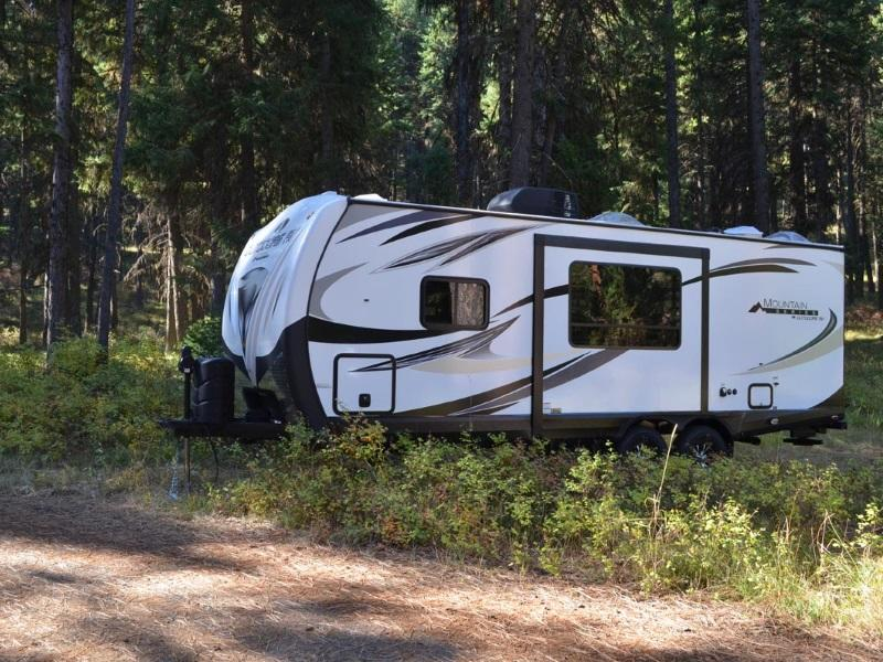 2019 outdoors rv creek side 18rbs parked in a shaded camping lot in the  woods