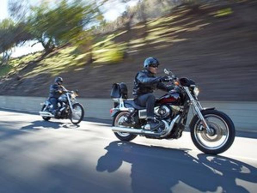 Picture of two Harleys being ridden down the road